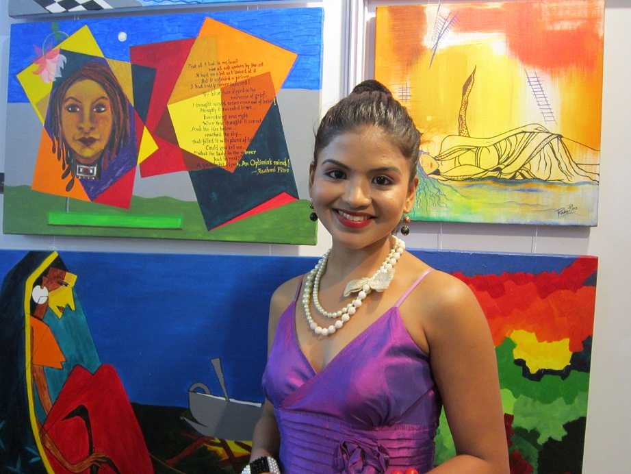 Rashmi Pitre with her paintings